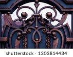 dressing forged metal doors ... | Shutterstock . vector #1303814434