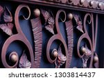 metal gates with forged elements | Shutterstock . vector #1303814437