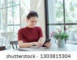 young woman shopping online... | Shutterstock . vector #1303815304