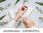 scientist pharmacist applying... | Shutterstock . vector #1303841911