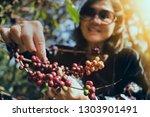 asian woman smiling face... | Shutterstock . vector #1303901491
