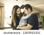 a father and a mother hugging... | Shutterstock . vector #1303932331