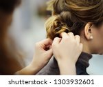 young woman bride getting her... | Shutterstock . vector #1303932601