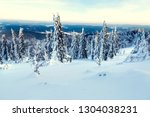 snow covered trees and a view...   Shutterstock . vector #1304038231