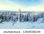 snow covered trees and a view...   Shutterstock . vector #1304038234
