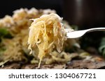 sauerkraut on a fork with a...   Shutterstock . vector #1304067721