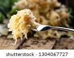 sauerkraut on a fork with a...   Shutterstock . vector #1304067727