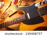 guitar on repair desk. vintage... | Shutterstock . vector #130408757