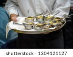 waiter carrying plates with... | Shutterstock . vector #1304121127