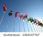 national flags waving on blue... | Shutterstock . vector #1304147767