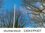 a ripped uk union jack flag... | Shutterstock . vector #1304199307
