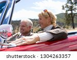 mature couple on road trip in... | Shutterstock . vector #1304263357