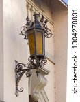 steel retro lantern on the... | Shutterstock . vector #1304278831
