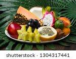 fresh thai fruits dish on palm... | Shutterstock . vector #1304317441