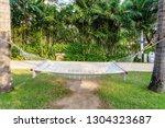 hammock on the beach in a sunny ... | Shutterstock . vector #1304323687