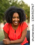 african american woman smiling...   Shutterstock . vector #1304502967
