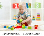 child toddler playing wooden... | Shutterstock . vector #1304546284