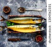 Stock photo appetizing smoked fish on kitchen board smoked mackerel 1304562331