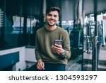 portrait of cheerful handsome... | Shutterstock . vector #1304593297