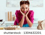 pretty pin up girl leaning up... | Shutterstock . vector #1304632201