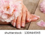 woman in a nail salon receiving ... | Shutterstock . vector #130464545