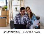 young couple moving in new home....   Shutterstock . vector #1304667601