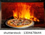 baked pizza in the wood oven | Shutterstock . vector #1304678644