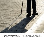 silhouette of man walking with... | Shutterstock . vector #1304690431