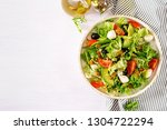 fresh salad with avocado ... | Shutterstock . vector #1304722294