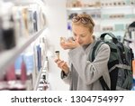 blond young female traveler... | Shutterstock . vector #1304754997