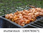 a row of skewers with pieces of ... | Shutterstock . vector #1304783671