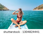 woman paddling a kayak by the... | Shutterstock . vector #1304824441