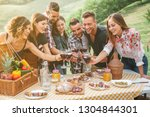 group of friends making a toast ... | Shutterstock . vector #1304844301