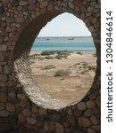 rock wall window to red sea in... | Shutterstock . vector #1304846614