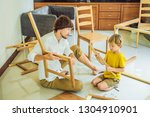 father and son assembling... | Shutterstock . vector #1304910901