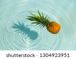 pineapple into water on sunny... | Shutterstock . vector #1304923951