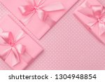 gift box with pink ribbon bow... | Shutterstock . vector #1304948854