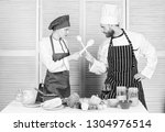 woman and bearded man culinary...   Shutterstock . vector #1304976514