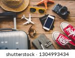 travel accessories on wooden... | Shutterstock . vector #1304993434