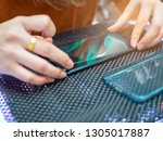 female protect plastic on phone ... | Shutterstock . vector #1305017887