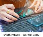 female protect plastic on phone ... | Shutterstock . vector #1305017887