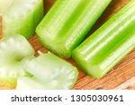 macro sliced celery on wooden... | Shutterstock . vector #1305030961