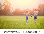 loving couple runs for hands... | Shutterstock . vector #1305033814