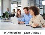coworkers sitting at table and... | Shutterstock . vector #1305040897