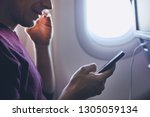 connection during flight. young ... | Shutterstock . vector #1305059134