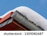 roof with snow on a sunny day... | Shutterstock . vector #1305082687