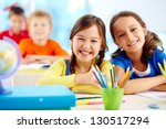 portrait of two diligent girls... | Shutterstock . vector #130517294