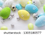 colorful easter eggs on white... | Shutterstock . vector #1305180577