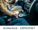 woman hand taking cup with...   Shutterstock . vector #1305225367