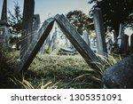 downfallen old rough tombstones ... | Shutterstock . vector #1305351091
